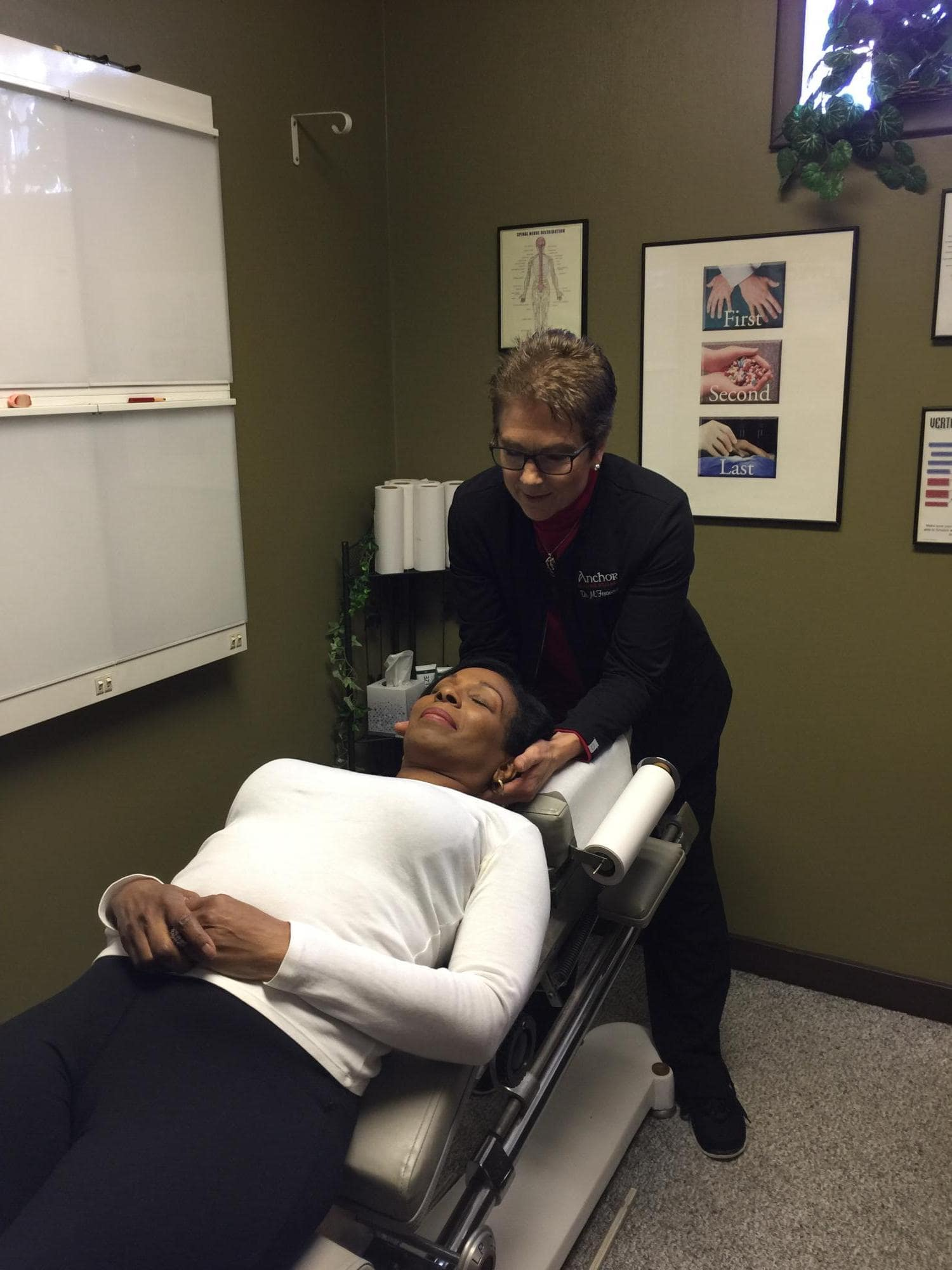 Massage Therapist Farmington with patient